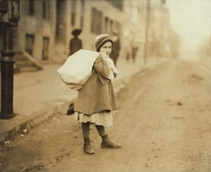nearly_9_a-m-_girl_about_8_yrs-_old_carrying_sack_of_hose_supporters_home